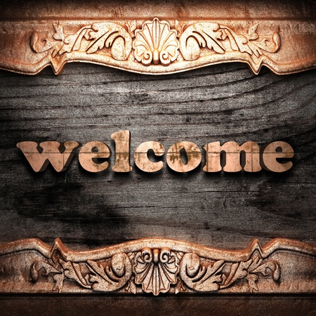 welcome sign: Golden word on wood