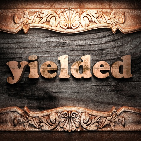 yielded: Golden word on wood