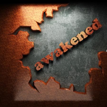 awakened: red wood word on concrete
