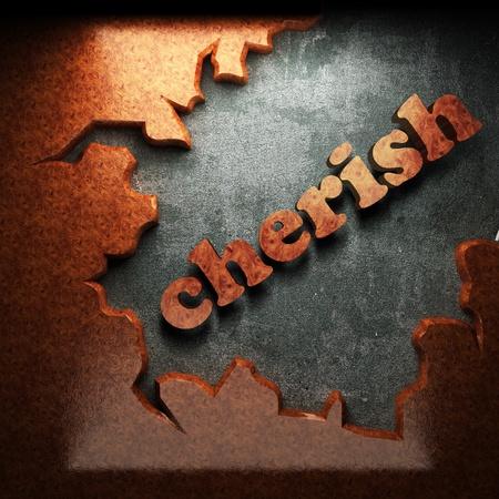 cherish: red wood word on concrete
