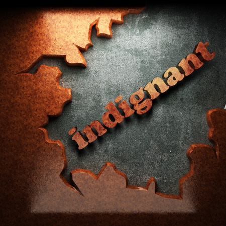 indignant: red wood word on concrete