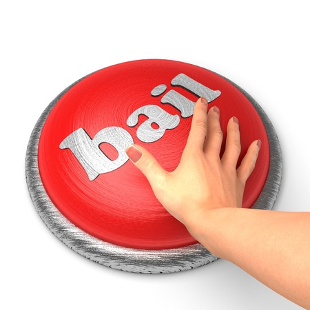 bail: Hand pushing the button