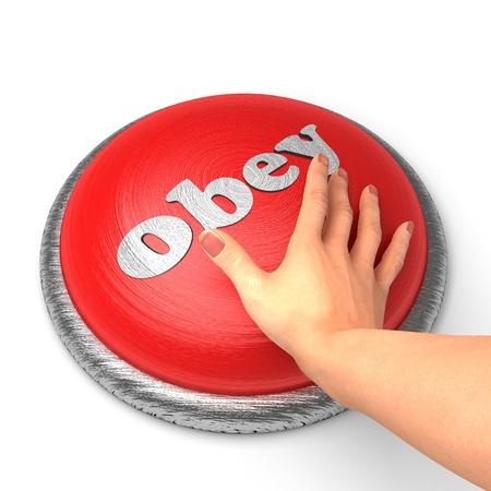 obedecer: Mano empujando el botón Foto de archivo