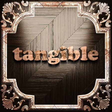 tangible: word with classic ornament made in 3D Stock Photo