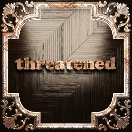 threatened: word with classic ornament made in 3D Stock Photo