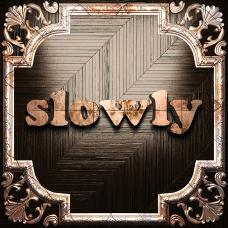 slowly: word with classic ornament made in 3D Stock Photo