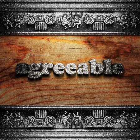 agreeable: iron word on wood made in 3D Stock Photo