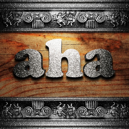 aha: iron word on wood made in 3D Stock Photo