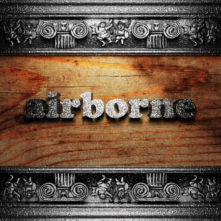 airborne: iron word on wood made in 3D Stock Photo