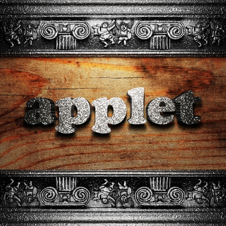 applet: iron word on wood made in 3D Stock Photo