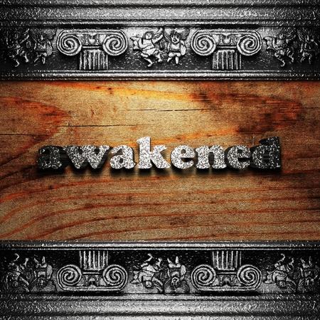 awakened: iron word on wood made in 3D Stock Photo