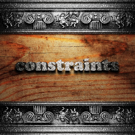 constraints: iron word on wood made in 3D Stock Photo