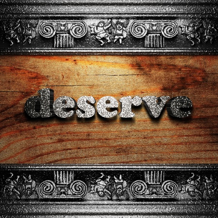 deserve: iron word on wood made in 3D Stock Photo