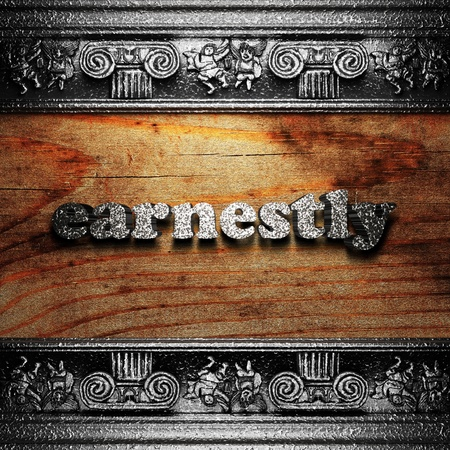 earnestly: iron word on wood made in 3D Stock Photo