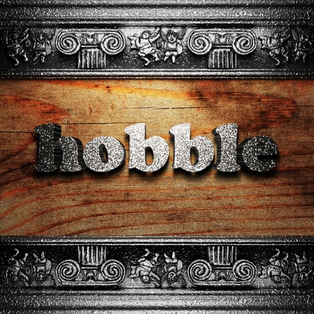 hobble: iron word on wood made in 3D Stock Photo