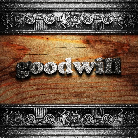 goodwill: iron word on wood made in 3D Stock Photo