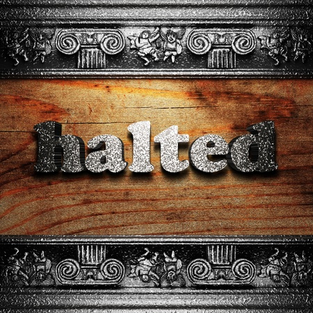 halted: iron word on wood made in 3D Stock Photo