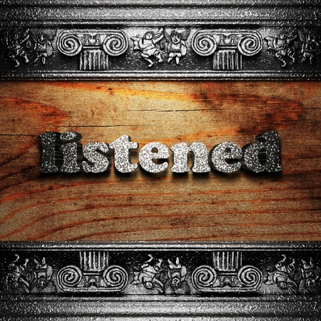 listened: iron word on wood made in 3D Stock Photo