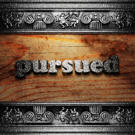 pursued: iron word on wood made in 3D Stock Photo