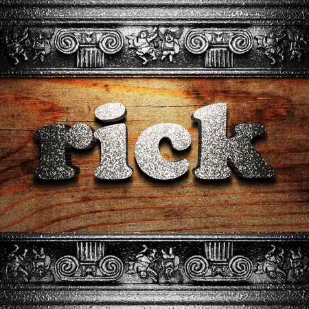 rick: iron word on wood made in 3D Stock Photo