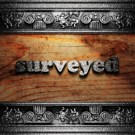 surveyed: iron word on wood made in 3D Stock Photo