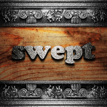swept: iron word on wood made in 3D Stock Photo