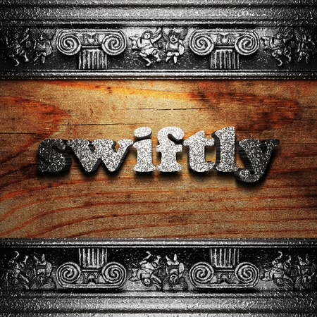 swiftly: iron word on wood made in 3D Stock Photo