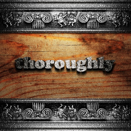 thoroughly: iron word on wood made in 3D Stock Photo