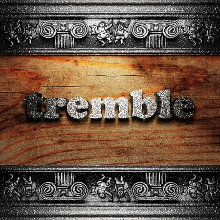 tremble: iron word on wood made in 3D Stock Photo