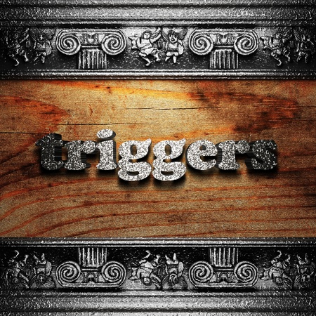 triggers: iron word on wood made in 3D Stock Photo