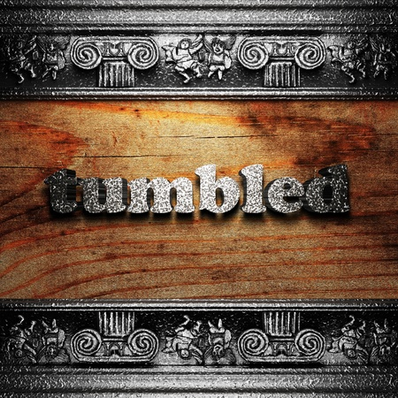 tumbled: iron word on wood made in 3D Stock Photo
