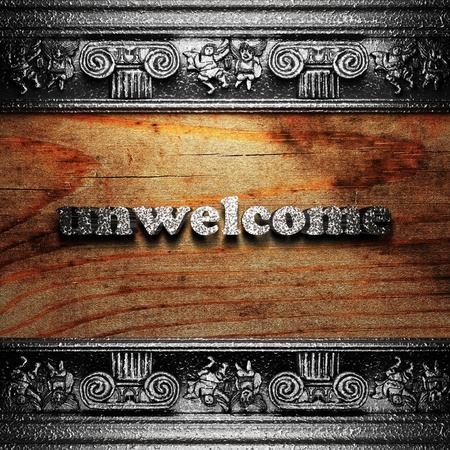 unwelcome: iron word on wood made in 3D Stock Photo