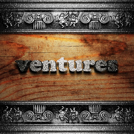 ventures: iron word on wood made in 3D Stock Photo