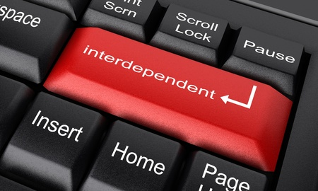 interdependent: Word on keyboard made in 3D