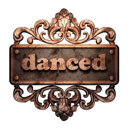 danced: Word on bronze ornament