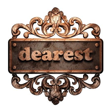 dearest: Word on bronze ornament