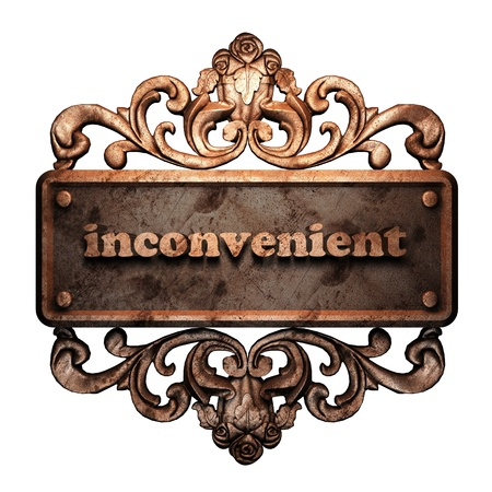 inconvenient: Word on bronze ornament