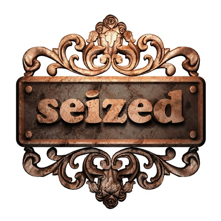 seized: Word on bronze ornament