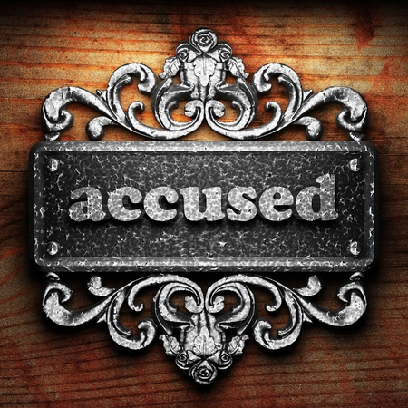 accused: Silver word on ornament