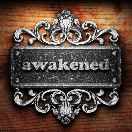 awakened: Silver word on ornament