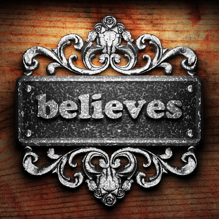 believes: Silver word on ornament