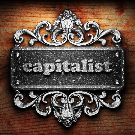 capitalist: Silver word on ornament