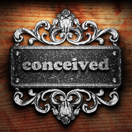 conceived: Silver word on ornament