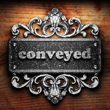 conveyed: Silver word on ornament