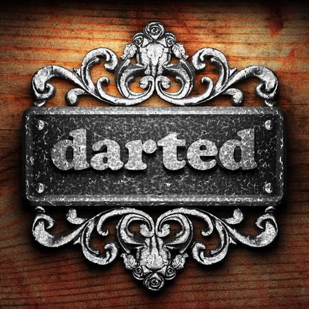 darted: Silver word on ornament