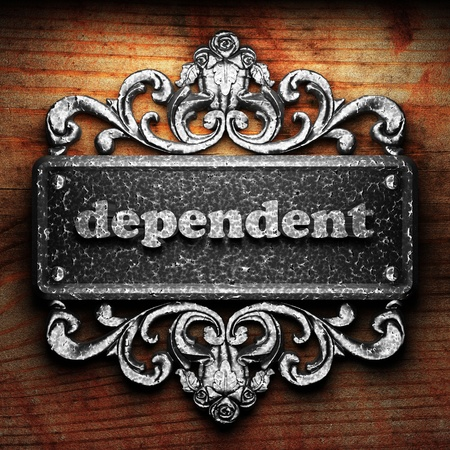 dependent: Silver word on ornament