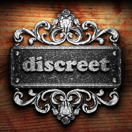 discreet: Silver word on ornament