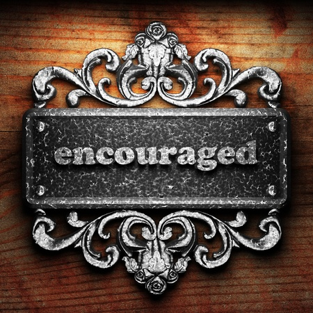 encouraged: Silver word on ornament