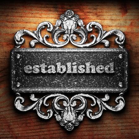 established: Silver word on ornament