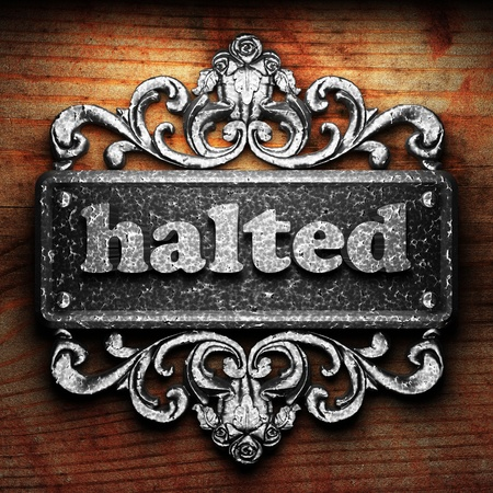 halted: Silver word on ornament